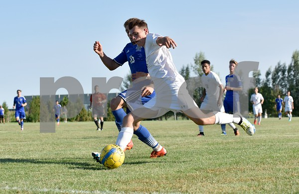 -Messenger photo by Britt Kudla<br /> Jack Gibson of Iowa Central passes against Iowa Lakes on Wednesday
