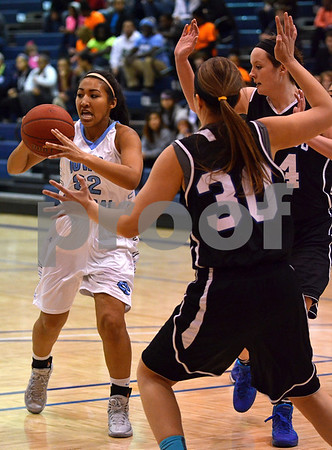 -Messenger photo by Britt Kudla<br /> Ashley Ray of Iowa Central looks to pass the ball while being covered by Kirkwood's Kirsten Larson on Saturday at HudgeFieldhouse