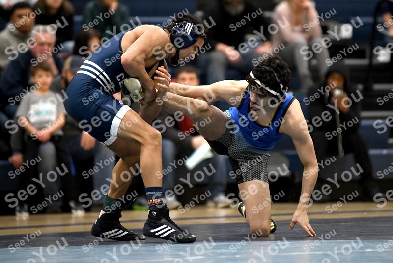 -Messenger photo by Britt Kudla<br /> Daniel Vargas of Iowa Central wrestles against Iowa Western Isaac Garcia on Wednesday at Hodges Fieldhouse