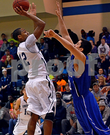 -Messenger photo by Britt Kudla<br /> Javonte Young of Iowa Central shoots a jump shot during the first half against Kirkwood on Satuday at Hudge Fieldhouse