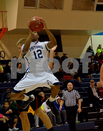 -Messenger photo by Britt Kudla<br /> Javonte Young of Iowa Central scores two points against Simpson on Monday at Hudges Field