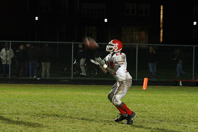 Amesbury Half Back, #17, Marion Wilder catches a punt.