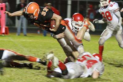 Ipswich Running back, #32 Steve Phaneuf, dives for extra yards