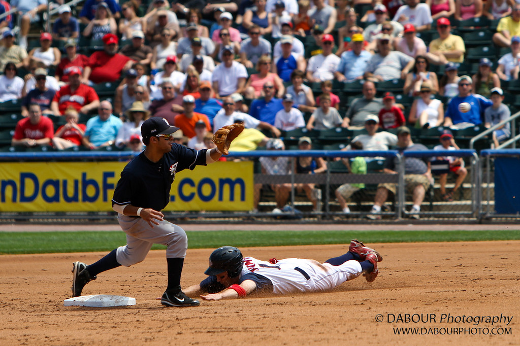The ball is right center on the man with the blue top.<br /> IronPigs-146