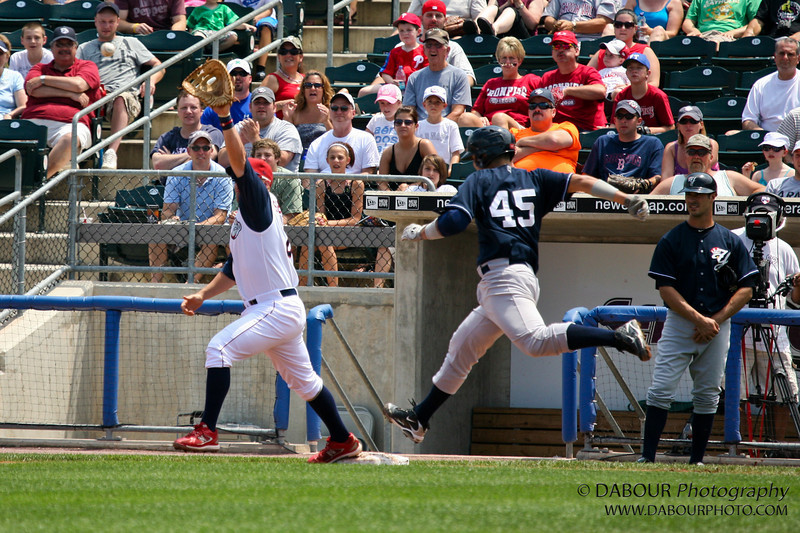 Theball is hard to see unfortunately. It's about 3 feet to the left of hit glove just below the chin of the man with the grey shirt with dark colored hat.<br /> IronPigs-120