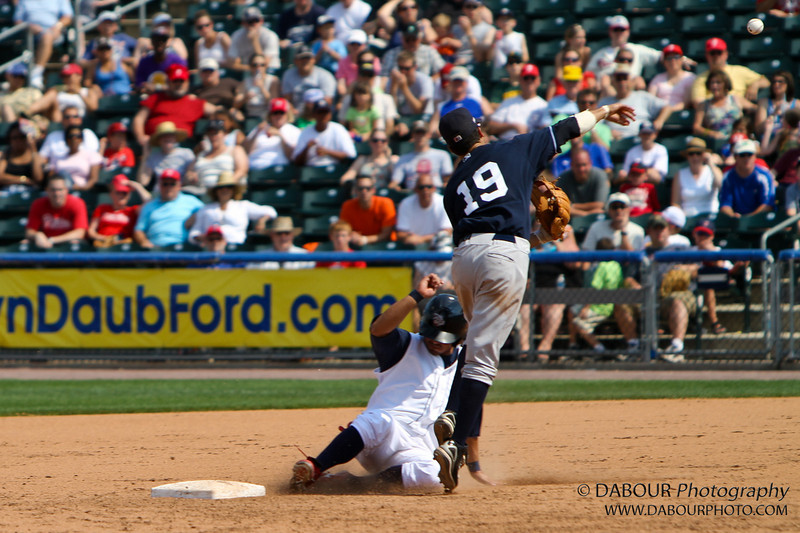 The ball is top right over the green seat. I don't recall if this was also a double play but he obviously was out at second.<br /> IronPigs-214