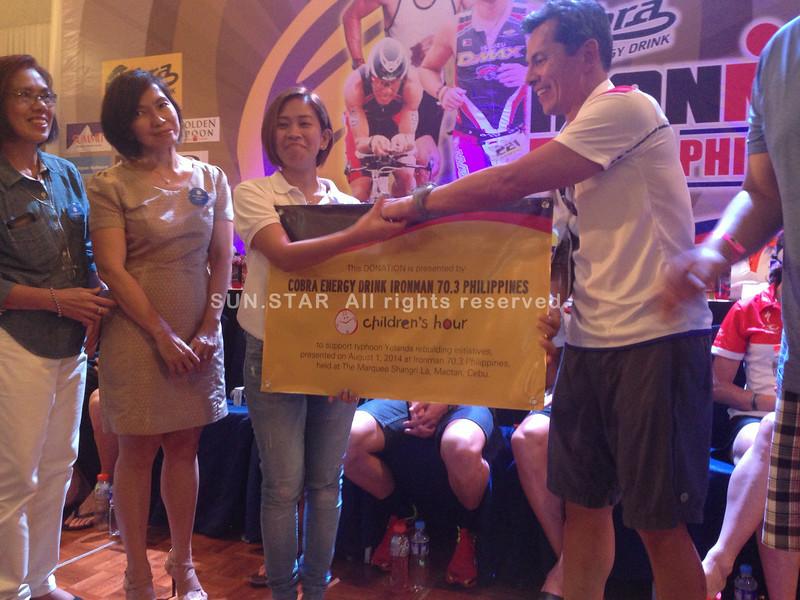 Ironman donates to Children's Hour
