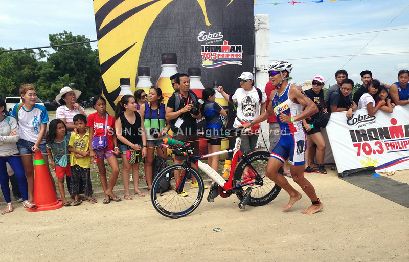 Filipino elite Arland Macasieb finishes the bike race