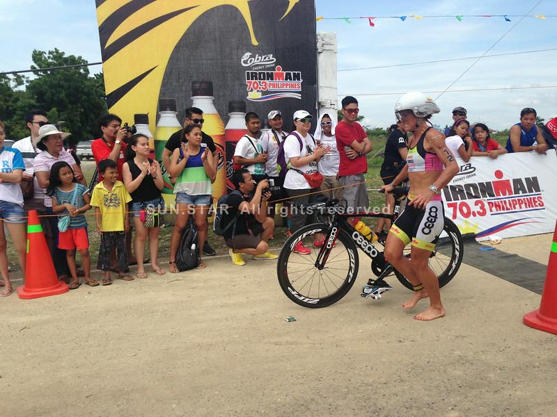 Professional triathlete Belinda Granger finishes the bike race