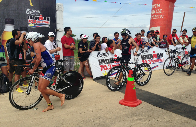 Triathletes finish the bike leg of Ironman 70.3 Philippines
