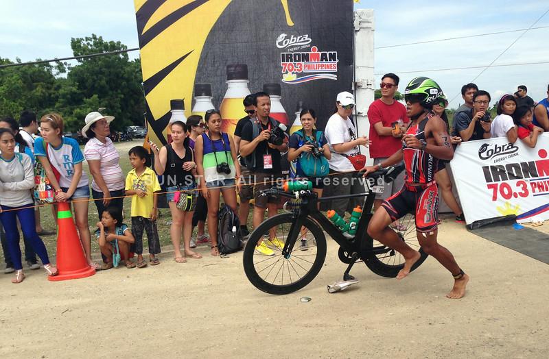 Filipino elite John Philip Duenas finishes the 90K bike