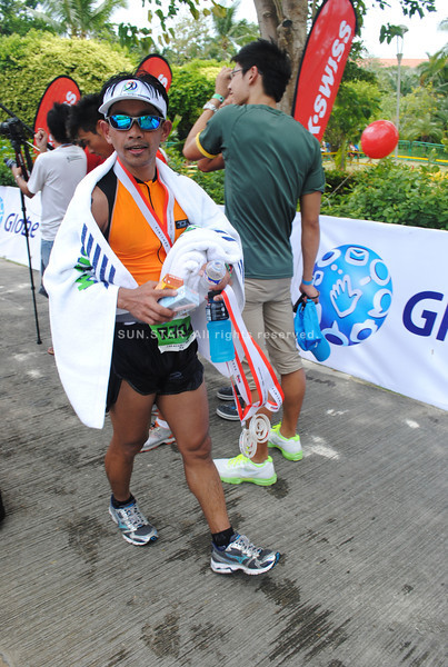 CEBU. An athlete who did the 21-km run during the relay arrives at the finish line.