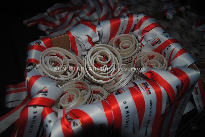 CEBU. Medals of the Ironman 70.3 Philippines Cebu designed by Cebuano designer Kenneth Cobonpue.