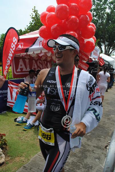 CEBU. Chris Aldeguer finishes his tough comeback Ironman race with a smile.