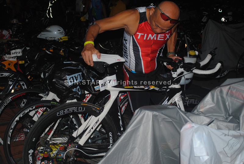 CEBU. Ironman 70.3 participant checks his bike condition.