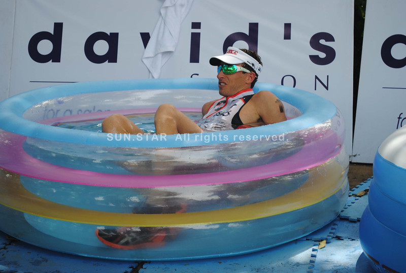 CEBU. Pete Jacobs taking his cold bath after finishing the race.