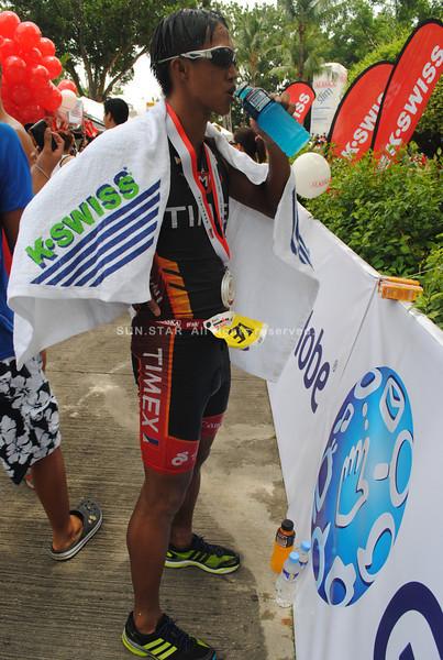 CEBU. A triathlete who finishes the race refreshes.