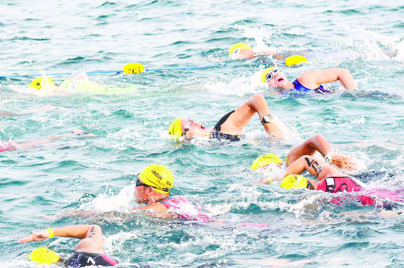 The triathlete swimming against the waves. (Sun.Star Photo/Allan Cuizon)