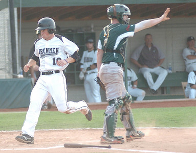 8-3-10 linda murphy  bot of 1st - ironmen #10 Matt McAllester (from westlake) crosses home plate  safely as the Miner's catcher #7 Chris Kay signals his fellow player not to throw the ball home.