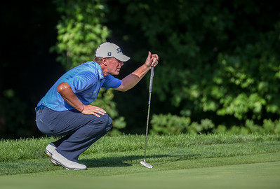 Steve Stricker lines up his putt on #12. He makes it to save bogey after pushing his tee shot into the woods.