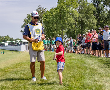 Zach Johnson's caddy has some fun with a young fan.