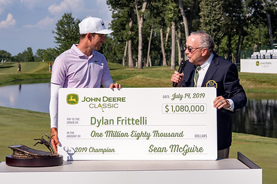 John Deere CEO Sam Allen presents Dylan Frittelli with the winnings.
