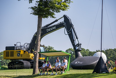 Tractor seats and excavator driver at the John Deere Classic.