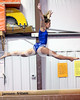 Clayton High's Kaitlyn Cron performs on the balance beam. Johnston County prep gymnasts competed in an area meet in Smithfield, N.C. on Friday, December 5, 2014.