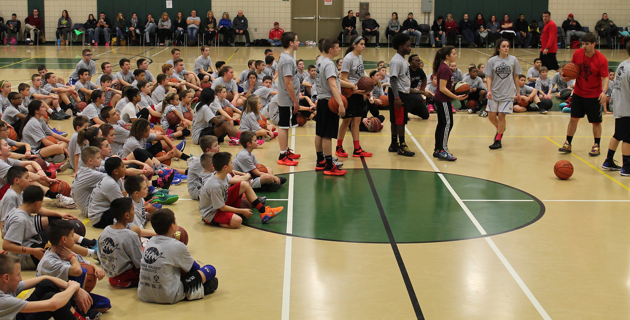 LAWRENCE PANTAGES / GAZETTE There were 150 sign-ups for Sunday's 3-hour clinic with Cleveland Cavaliers player J.R. Smith that was held at the Medina Community Recreation Center. Entrants had to be at least age 10. The event was a sellout. Robbie Haught of the Cleveland Basketball School (right, holding ball) led the clinic before Smith's arrival.