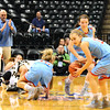 Christopher Aune | The Herald-Tribune<br /> It wasn't easy becoming state champs. Kayla Bowling picks up a ball scooted out of the fray by Jordan Day, leaving Lady Dragons in the rubble, as JCD head coach Scott Smith applauds their effort and energy.