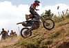 Going Over the Bars during the Jack Pine Gypsies Pro Hill Climb in Sturgis South Dakota - Photo by Pat Bonish