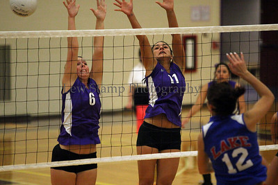 Jackson High School's Stephanie Douglas (left) and Arielle Elsass try to block the ball from Lake High School's Sarah Tobias  on October 6, 2009, in Jackson Township, Ohio.  By LewStampPhotography.smugmug.com