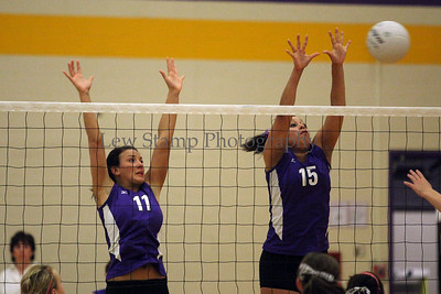 Jackson High School's Ariell Elsass (left) and Britney Terrell go up to block Lake High School  on October 6, 2009, in Jackson Township, Ohio.  By LewStampPhotography.smugmug.com