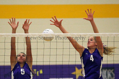 Jackson High School's Katie Zito (left) and Caroline Houston are  unable to block hit from Lake High School on October 6, 2009, in Jackson Township, Ohio.  By LewStampPhotography.smugmug.com