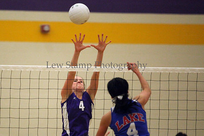 Jackson High School's Caroline Houston (left) goes up to try to block  the ball from Lake High School's Brier Sanner  on October 6, 2009, in Jackson Township, Ohio.  By LewStampPhotography.smugmug.com
