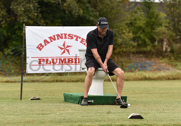 """Jim Terry from Team Austin Bank tries his luck at the """"toilet hole"""" during the Jacksonville Chamber Golf Tournament and Golf Ball Drop on Friday. The first-time event took place at Cherokee Ranch Golf Club and also included a fish fry and entertainment by Boogie Butt Productions."""