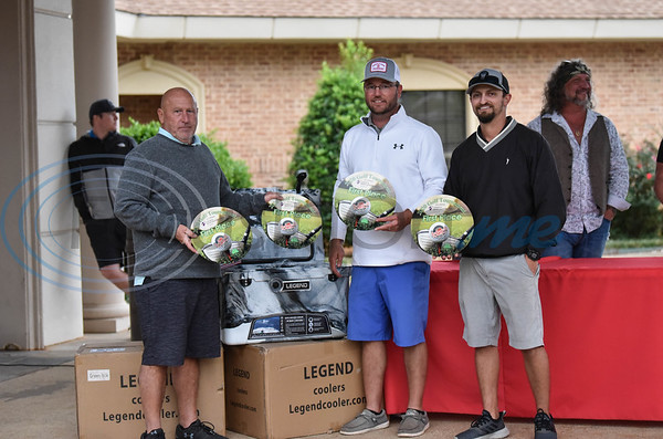 (From left) Steve Hillburn, Grady Underwood and Hunter Skelton of Team Bannister took home first place at the Jacksonville Chamber Golf Tournament and Golf Ball Drop at Cherokee Ranch Golf Club on Friday. The winning team took home a Legend cooler and first place award designed by Congratulations!.