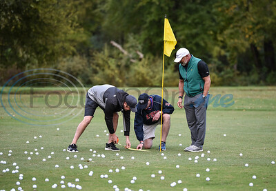 Member of Team Christus, who were Title Sponsors for the event, measure the ball closest to the hole at the Jacksonville Chamber Golf Tournament and Ball Drop. The event took place at Cherokee Ranch Golf Club on Friday.