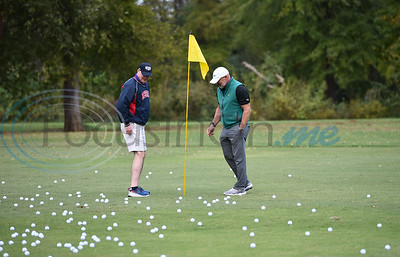 Christus Title Sponsor Dr. Peter Sirianni (right) and Barry Lofquist exam more than 600 golf balls dropped from a helicopter during the Jacksonville Chamber Golf Tournament and Ball Drop on Friday.