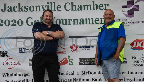 Gene Keenon (left) and Duane Weatherford of Republic Services smile for a photo at the Jacksonville Chamber Golf Tournament and Golf Ball Drop at Cherokee Ranch Golf Club on Friday. The event also included a fish fry and entertainment.