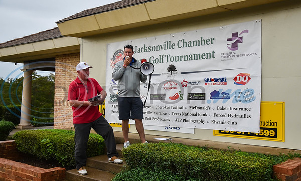 Cherokee Ranch Golf Club General Manager Jerry Black (left) and Club President Anthony Williams welcome the teams and announce rules during the Jacksonville Chamber Golf Tournament and Golf Ball Drop on Friday.