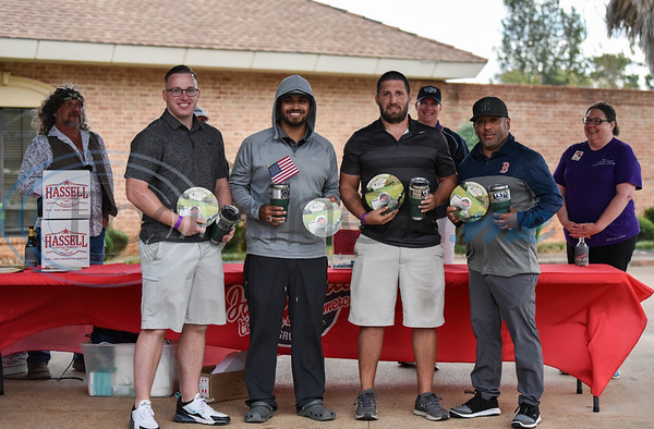 Member from Team Southside Bank (from left) Steven Markasky, Justin Rodriguez, Zac Vining and Ernest Rodriguez smile after winning third place at the Jacksonville Chamber Golf Tournament and Golf Ball Drop on Friday. The first-time event took place at Cherokee Ranch Golf Club.
