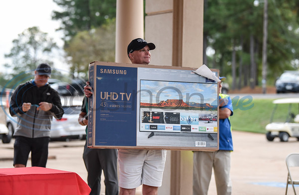 Christus Administrator and Jacksonville Chamber Golf Tournament Title Sponsor Barry Lofquist holds up a door prize during the event held on Friday at Cherokee Ranch Golf Club.