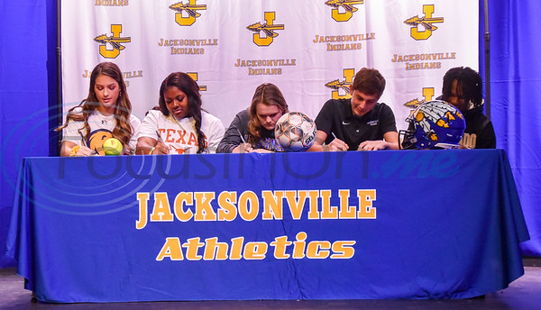 Jacksonville student-athletes (from left) Saylor Williams, Jordyn Whitaker, Kelsey Traylor, Cooper Coughlin and Chris Carpenter sign their Letters of Intent to their respective colleges on National Signing Day. The event took place at the high school auditorium on Wednesday, February 5. (Jessica T. Payne/Tyler Morning Telegraph)