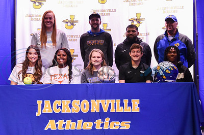Jacksonville student-athletes (from left) Saylor Williams, Jordyn Whitaker, Kelsey Traylor, Cooper Coughlin and Chris Carpenter smile for a photo with their coaches on National Signing Day. The event took place at the high school auditorium on Wednesday, February 5. (Jessica T. Payne/Tyler Morning Telegraph)