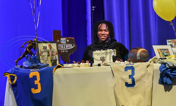 Jacksonville student-athlete Chris Carpenter signs his Letter of Intent to attend Colorado University on football scholarship on National Signing Day. The event took place at the high school auditorium on Wednesday, February 5. (Jessica T. Payne/Tyler Morning Telegraph)