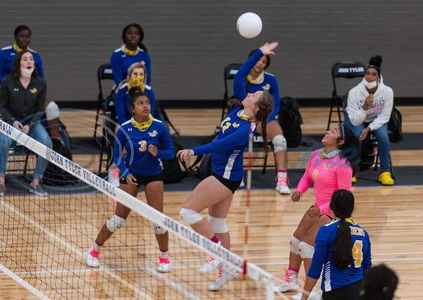 Jacksonville High School varsity volleyball player Bethany Lavender spikes the ball during their game against Tyler High School on Tuesday, Oct. 20, 2020.