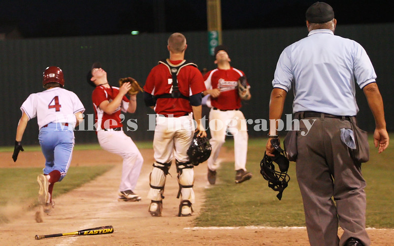 a little crowded on the baseline as 4 hits a pop up and the pitcher 1 Nick Hefley (left) makes the play while the catcher 7 Landon Colson and 1st baseman 13 DJ Dickson watch for the ball