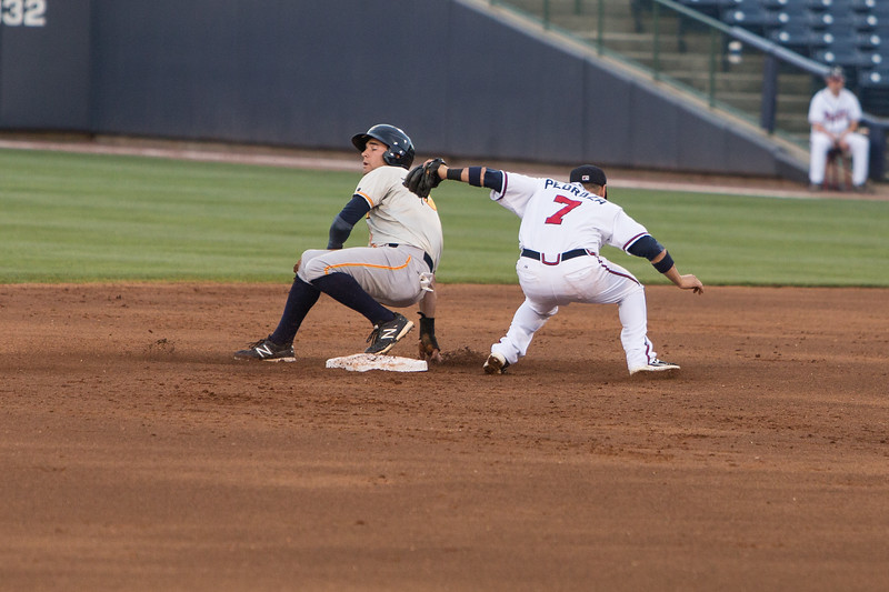 Jaime Pedroza putting a tag on a base stealer
