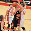 Altamont's Ryan Mayhaus drives toward the hoop at Vandalia. Mayhaus had nine rebounds, but the Indians fell to the Vandals 58-36.